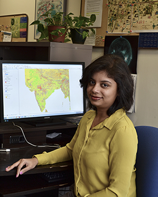 photo of Pinki Mondal at her workstation
